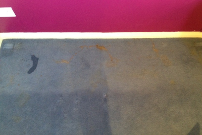 Carpet with oil and rust stains